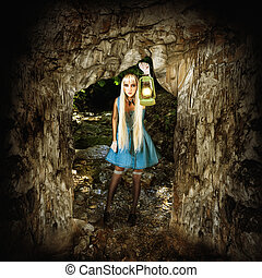 Woman illuminates path in a dark cave - Adventure concept....