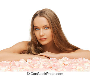woman with rose petals - health and beauty concept -...
