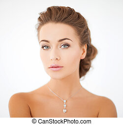 woman wearing shiny diamond pendant - beauty and jewelry...
