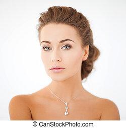 woman wearing shiny diamond pendant - beauty and jewelry...