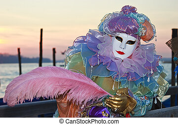 Colorful clown at the sunrise in Venice