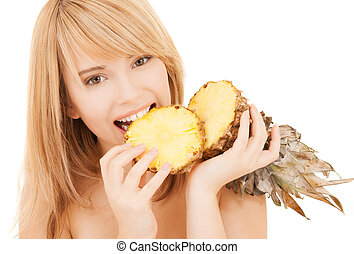 happy girl with pineapple - healty food and nutrition...