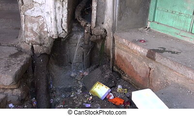 old broken water-pipe in India - old broken water-pipe in...