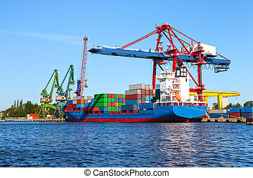 Seaport crane and huge container cargo ship ready for...