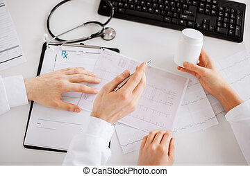 two doctors prescribing medication - healthcare, hospital...