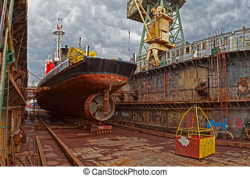 Dry dock - Ship for repairs in large floating dry dock.