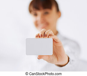businesswoman showing blank card