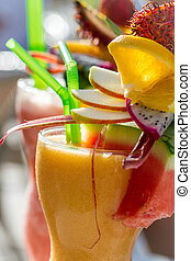 Closeup of drink with watermelon and fresh fruits
