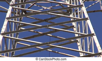 High-voltage electric tower metal construction and sky