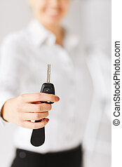 woman hand holding car key - business, banking, vehicle,...