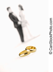 Pure gold wedding rings with porcelain bride and groom...