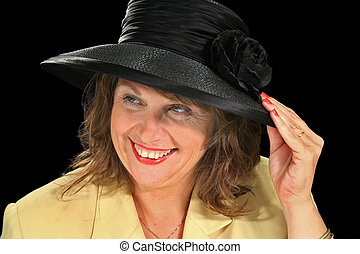 Black Hat Female 4 - Middle aged female smiling and holding...