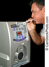 Breath Test Machine 1 - Man tests his alcohol level with a...
