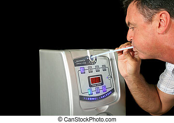 Breath Test Machine 2 - Man tests his alcohol level with a...