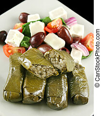Greek Dolmades - Greek dolmades wrapped with vine leaves and...