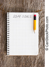 Goals of year 2014 - Notebook with pencil and goals of year...