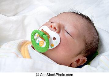 Newborn Baby With Pacifier Sleeping