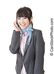 Asian business woman talking on cell phone - Young asian...