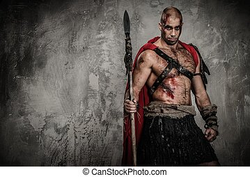 Wounded gladiator in red coat holding spear