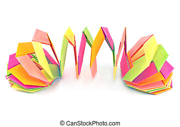 Colorful origami paper shapes isolated on white