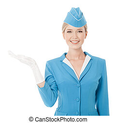 Charming Stewardess Dressed In Blue Uniform Holding In Hand...