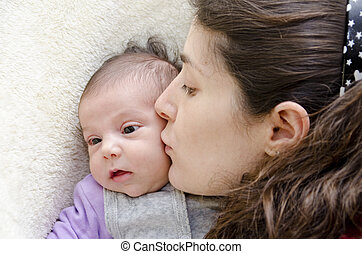 Mother kissing new born