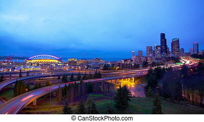 Seattle City Lights - Seattle skyline with traffic at dusk...