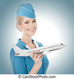 Charming Stewardess Holding Airplane In Hand. - Charming...