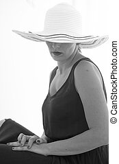 Portrait of woman in a straw hat - Beautiful girl in a straw...