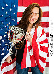 Sportswoman Holding Trophy Against North American Flag