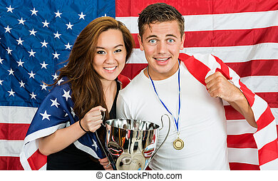 Two American Sports fans - Two Americans posing as athletes,...