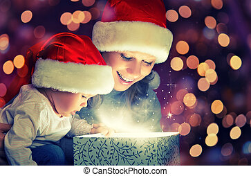 Christmas magic gift box and a happy family mother and baby...
