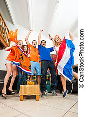 Ecstatic Dutch fans - Dutch Sports fans cheer ecstatically...