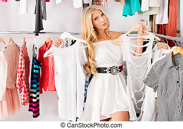 autumn sale - Fashionable young woman shopping in a clothing...