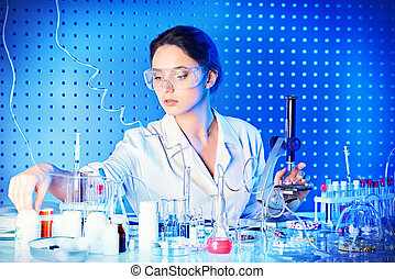working process - Employee of the laboratory in the working...