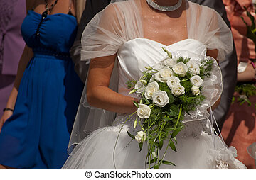 bride with wedding dress and bouque - wedding scene with...