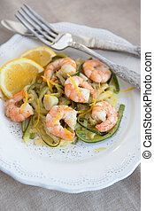 Zucchini noodles with prawns and lemon zest - Zucchini cut...