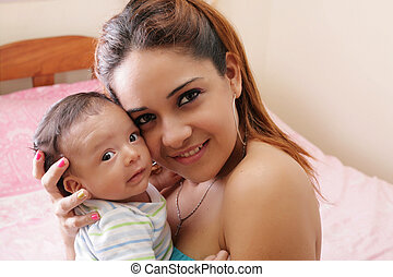 Portrait of a beautiful hispanic happy mother with smiling...