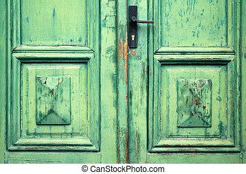 Old flaked classic green door and door handle