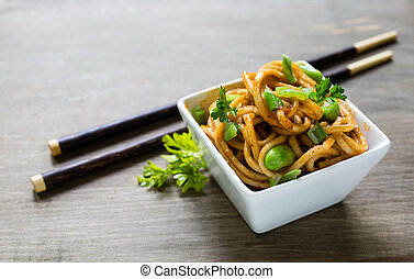 Spicy Noodles - Spicy asian noodle dish with chopsticks.