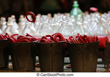 Carnival Ring Toss - Red rings in buckets are tossed at...