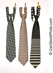 Ties. - Three Ties Hanging On a Rope With Wooden Pegs.