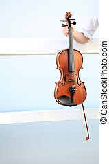 Female hand with a violin outdoor