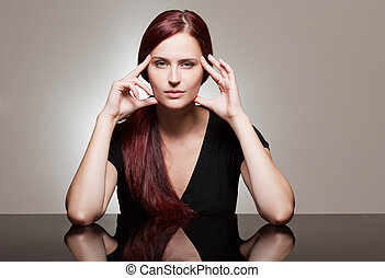 Redhead beauty with strong facial expression. - Portrait of...