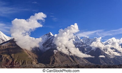 Clouds over glacier Inylchek. Kirgystan, central Tien Shan -...