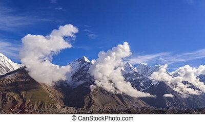 Clouds over glacier Inylchek. Kirgystan, central Tien Shan -...