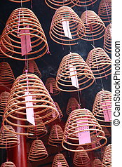 chinese joss sticks - group of chinese joss sticks hang in...