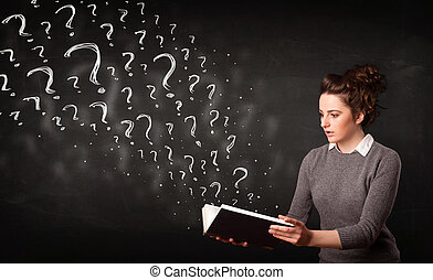 Confused woman reading a book with question marks coming out...