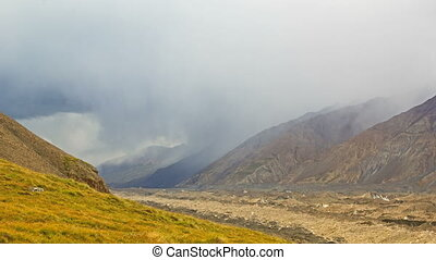 Rain in the mountains. Kirgystan, central Tien Shan. 4K -...