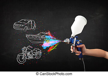 Man with airbrush spray paint with car, boat and motorcycle...
